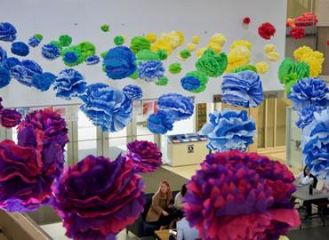 Flowers hanging from the ceiling of Sidney Smith Hall