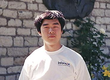 Greg Chen posing on campus in 1999.