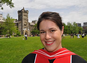 Christine Hone-Buske in front of University College wearing graduation gown.