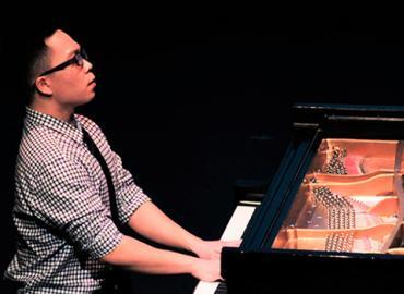 Ken Yang playing the piano