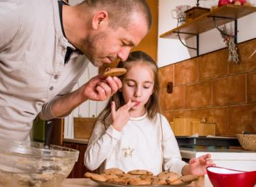 A family smelling cookies.