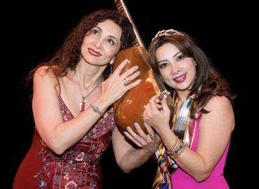 Two women holding an instrument