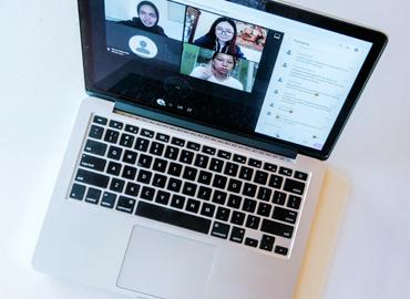 A laptop with various photos of participants.