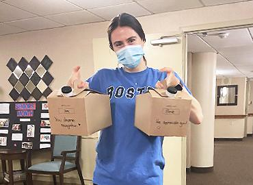 Vanessa Rezai-Stevens holding two boxes of refreshments