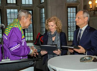 Elder Andrew Wesley presents the final report of U of T's Truth and Reconciliation Steering Committee to Vice-President and Provost Cheryl Regehr and President Meric Gertler