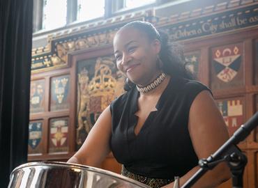 Suzette Vidale standing behind drum.