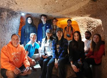 Students and professor in a cave