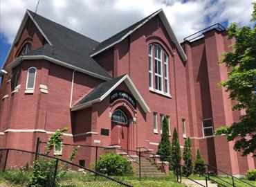 A photograph of a large red building - the United Memorial Church in Halifax.