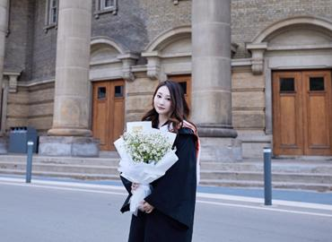 Viki Yichen Tao standing in front of Convocation Hall