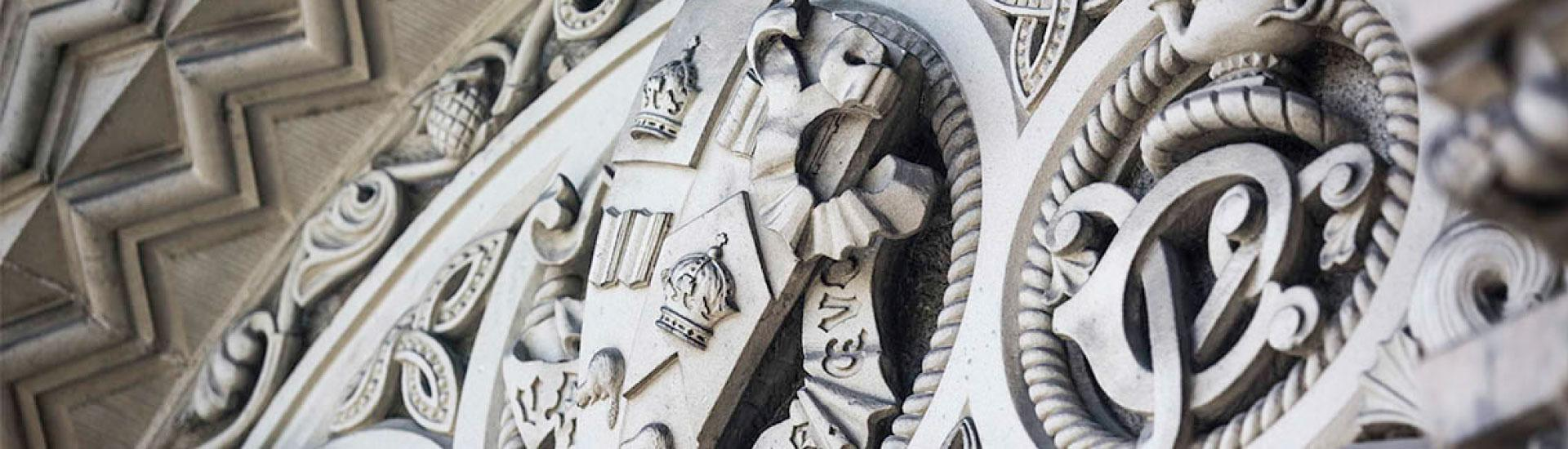 Close up of carved University of Toronto coat of arms